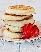 A stack of crumpets with strawberries (Great Britain)