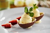 White chocolate mousse with peppermint served in chocolate egg halves for Easter