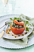 An oven-roasted tomato filled with spinach, bacon and cheese