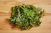 Fresh rocket leaves on a wooden surface