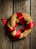 A bread wreath with sesame seeds for Christmas