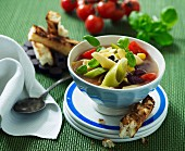 Minestrone with pasta served with grilled bread