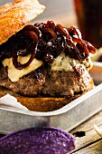Grilled lamb burger with blue cheese and caramelised onions