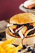 A veggie burger with a bean patty, Camembert and a blueberry and balsamic chutney