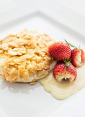 Brie cheese with roasted almonds and fresh strawberries