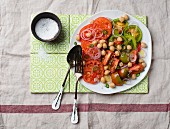 Chickpea and tomato salad with onion rings