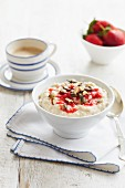 Rice pudding with strawberries and chopped nuts