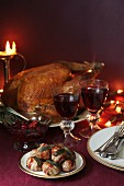 Roast turkey, pigs in blankets topped with sage and red wine for Christmas