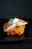 Salmon on sweet potato mash topped with sour cream and chives