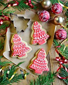 Christmas tree-shaped shortbread biscuits with red and white icing