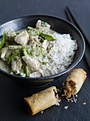 Green Thai chicken curry served with a vegetable spring roll