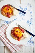 Peach puff pastry tart with raspberry sauce and ice cream
