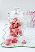 Pink macaroons in a sweetie jar