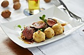 Saddle of venison with rosehip sauce and semolina dumplings