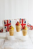 Red and yellow soft-serve ice cream in cones