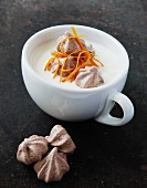 Panna cotta with chocolate meringues and orange zest