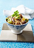 Noodles with mushrooms and spring onions