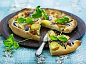 Pizza with potatoes, red onions and basil