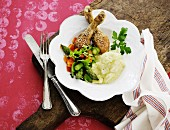 Sesame chicken with mashed potatoes and vegetable salad