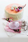 An Easter cake decorated with a bird and sugar eggs