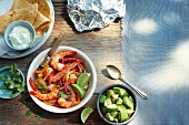 Corn tortillas, prawn salad, avocado and sour cream