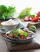 Chilli con carne with coriander and a side of rice