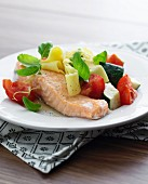 Salmon with pappardelle, tomatoes and courgette