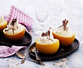 Oranges filled with orange cream garnished with chocolate curls