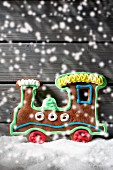 A gingerbread locomotive with falling artificial snow