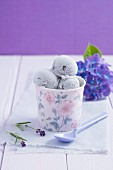 Lavender ice cream in a rose-patterned tub