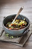 Beluga lentil stew with savoy cabbage, tomatoes and carrots