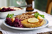 Tempeh schnitzel with red cabbage and wheat Spätzle (soft egg noodles from Swabia)