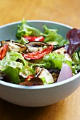 A mixed salad with grilled vegetables and a balsamic vinaigrette