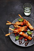 Chicken skewers with sweet-and-sour sauce and chili rings