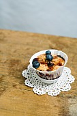 A muffin with blueberries and blueberry syrup