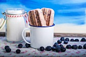 Blueberry ice cream sticks in a coffee cup