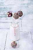 Chocolate cake pops decorated with sugar sprinkles