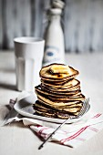Pancakes with melting butter and maple syrup