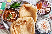 Chole bhatura and yoghurt (fried bread with a spicy chickpea sauce and yoghurt, India)