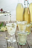 Homemade cauliflower lemonade being poured into glasses