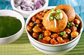 Chole bhatzra and aloo tikki (spicy chickpeas, and potato cakes, India)