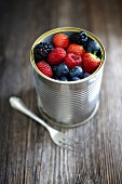 Fresh berries in a tin can