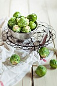 Peeled Brussels sprouts in metal bucket and next to it