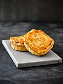 Mini meat pies on a wooden board