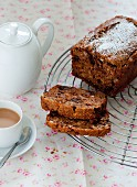 Chocolate and banana cake, sliced, served with coffee
