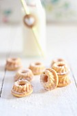 Mini Bundt cakes on a white wooden table
