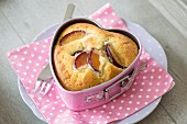 A plum cake in a heart-shaped baking tin
