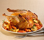 Roast turkey with rosemary, carrots and potatoes