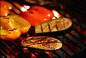 Grilled courgettes and peppers on a barbecue