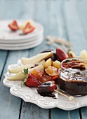 Fresh and candied fruits with a dark chocolate dip